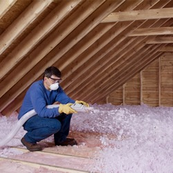 Blowing Insulation into an Attic - Get Coastal Exteriors